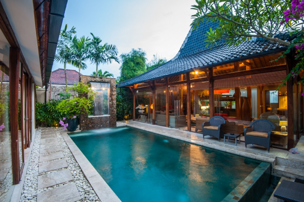 Seminyak private villa Bali with a private pool and living room semi outdoor.